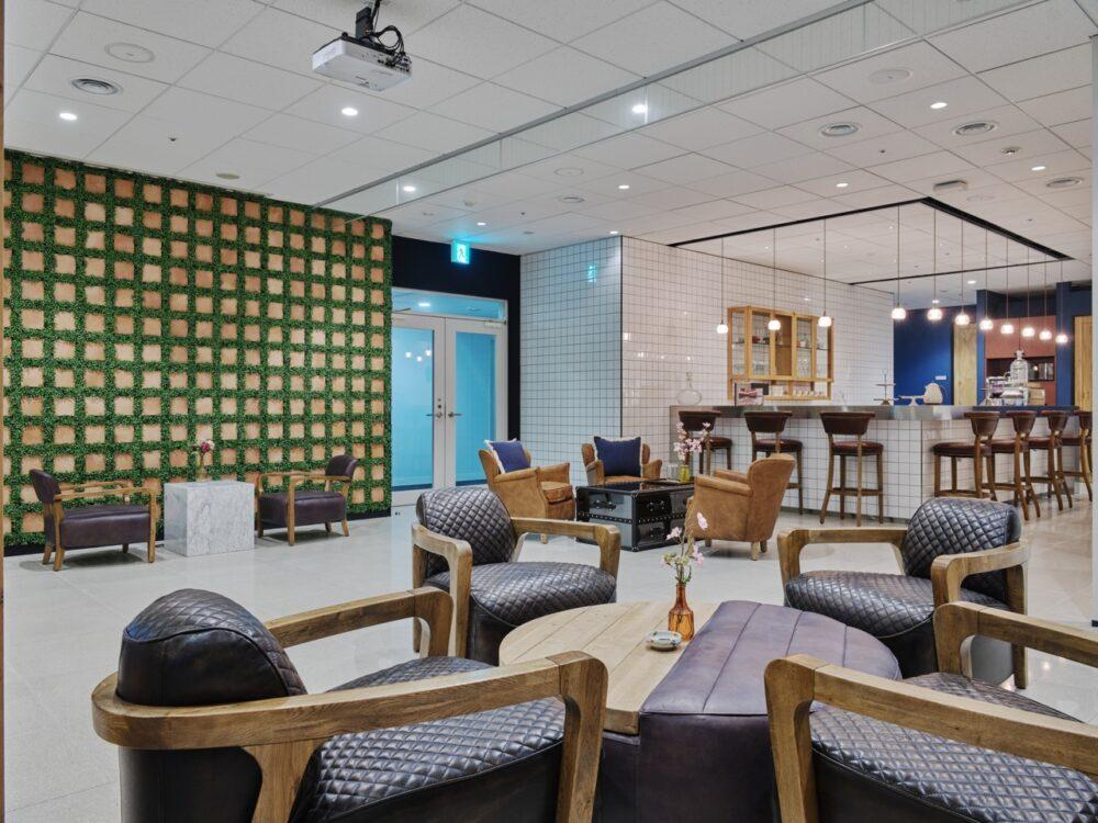 MMCB - Lounge with green wall and coffee bar